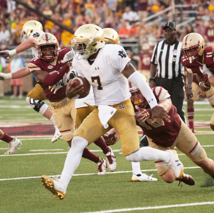 Irish junior quarterback Brandon Wimbush escapes a Boston College during Notre Dame's 49-20 win over the Eagles on Sept. 16 at Alumni Stadium in Chestnut Hill, Massachusetts.