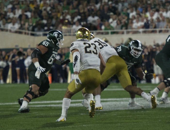 Irish senior linebacker Drue Tranquill reads the offense and looks to attack the line of scrimmage during Notre Dame's 38-18 win over Michigan State on Saturday at Spartan Stadium.