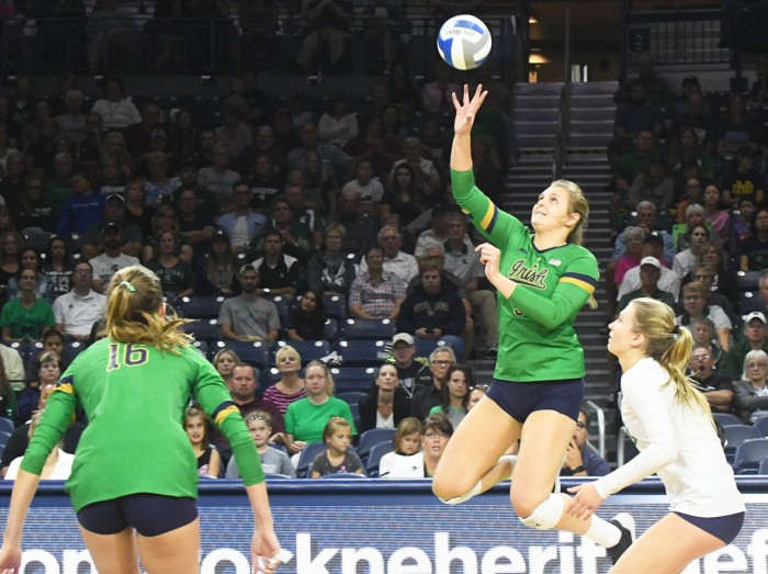 Irish junior outside hitter Rebecca Nunge tips the ball during Notre Dame's 3-0 win over Michigan State at Purcell Pavilion on Sept. 15.
