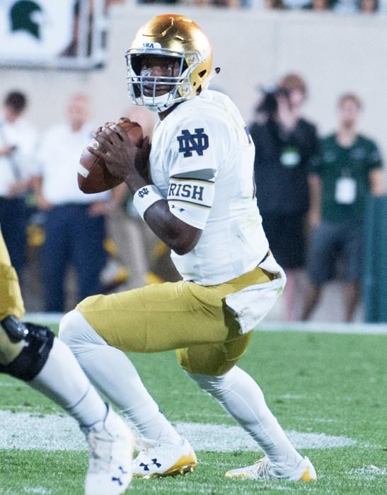 Irish junior quarterback Brandon Wimbush surveys the field and looks to pass during Notre Dame's 38-18 win over Michigan State on Saturday at Spartan Stadium in East Lansing, Michigan.