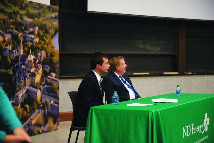 Mayors Pete Buttigieg and James Brainard of South Bend and Carmel, respectively, speak on the environmental impact of cities Thursday.