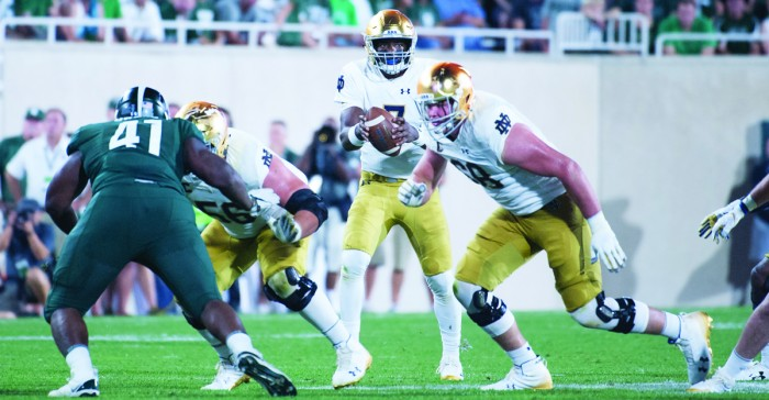 Irish junior quarterback Brandon Wimbush handles the snap during Notre Dame's 38-18 win over Michigan State on Saturday in East Lansing, Michigan.