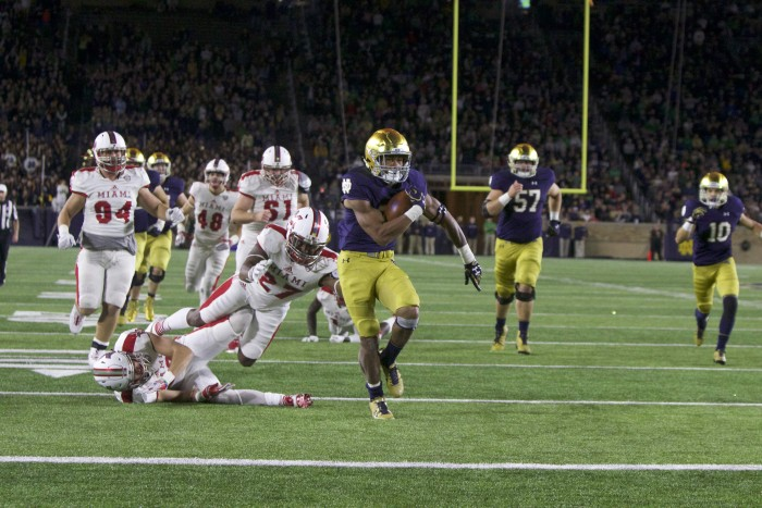 Irish sophomore running back Deon McIntosh slips past a defender during a 26-yard touchdown run in Notre Dame's 52-17 win over Miami (OH) on Saturday.