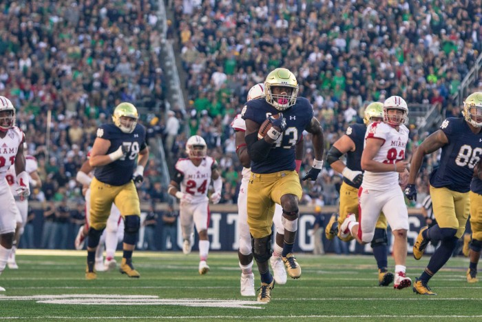 Irish junior running back Josh Adams breaks away from the back for a touchdown run during Notre Dame's 52-17 win over Miami (OH) on Saturday at Notre Dame Stadium.