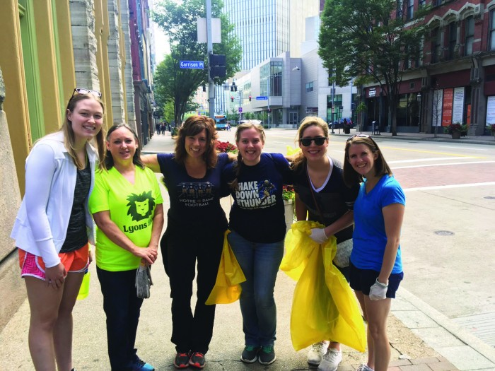 Members of the Notre Dame Club of Pittsburgh gather to complete community service before a Notre Dame football game.