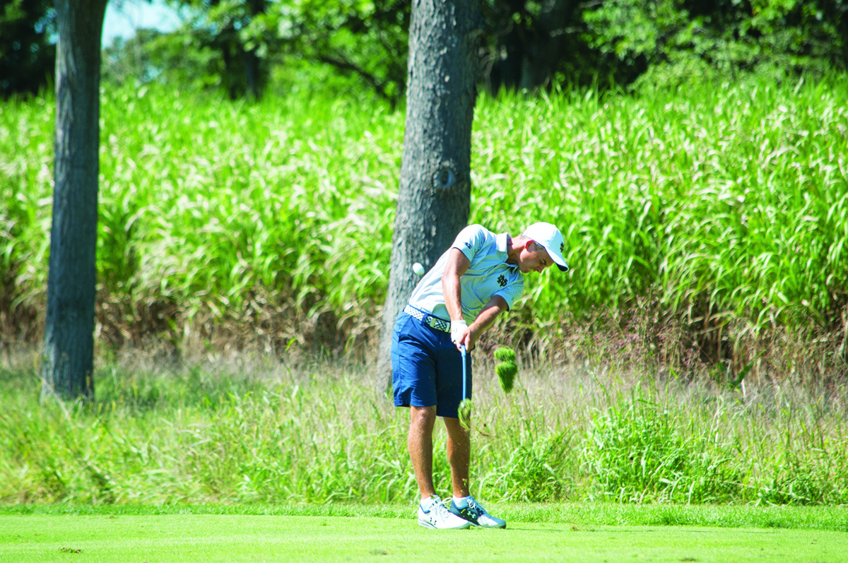 Irish sophomore John Felitto hits an iron during the Notre Dame Kickoff Challenge on Sept. 3, 2016, at Warren Golf Course.