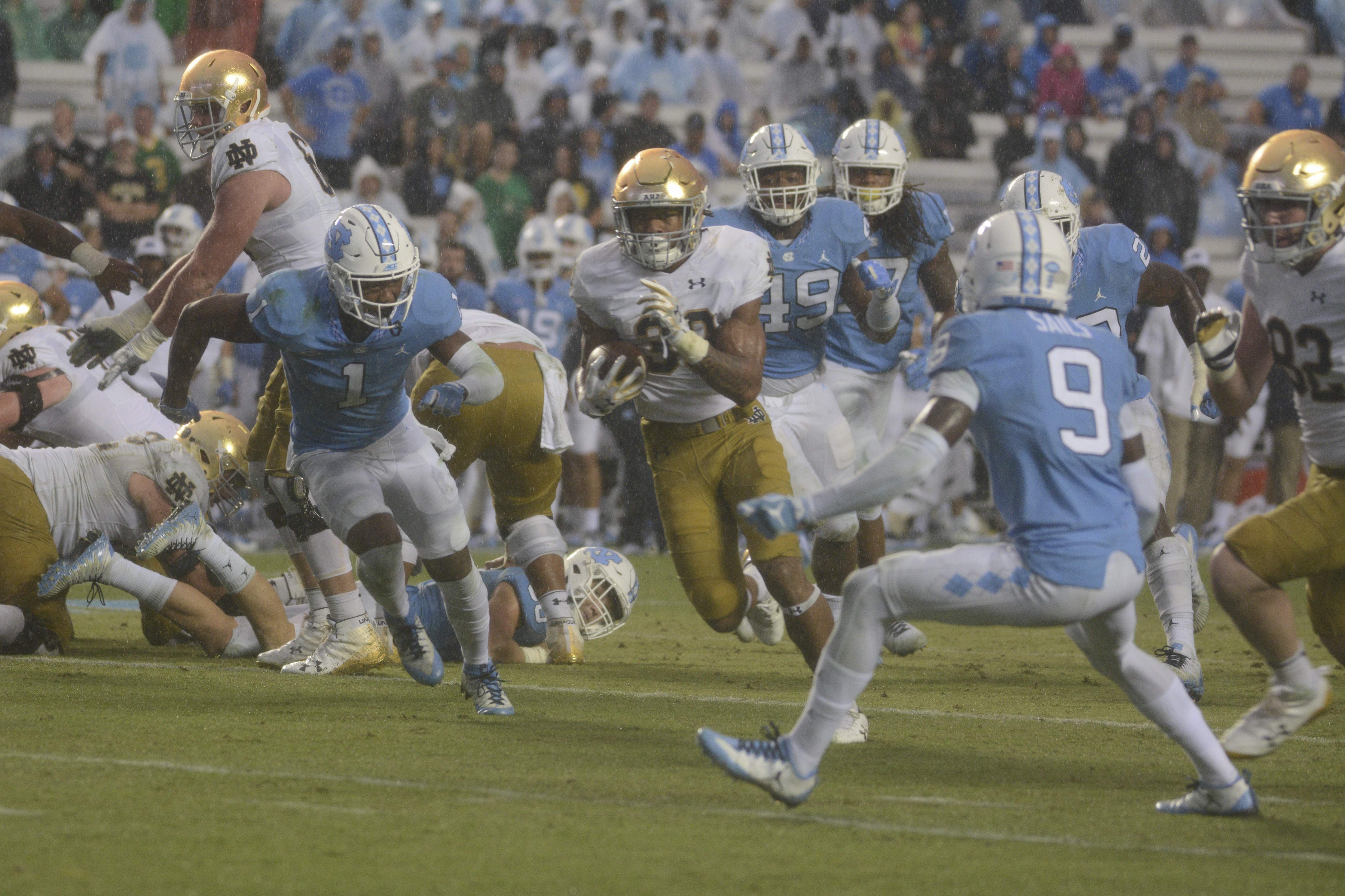 Irish sophomore running back Deon McIntosh skirts around a defender during Notre Dame's 33-10 win over North Carolina on Saturday at Kenan Memorial Stadium in Chapel Hill, North Carolina.