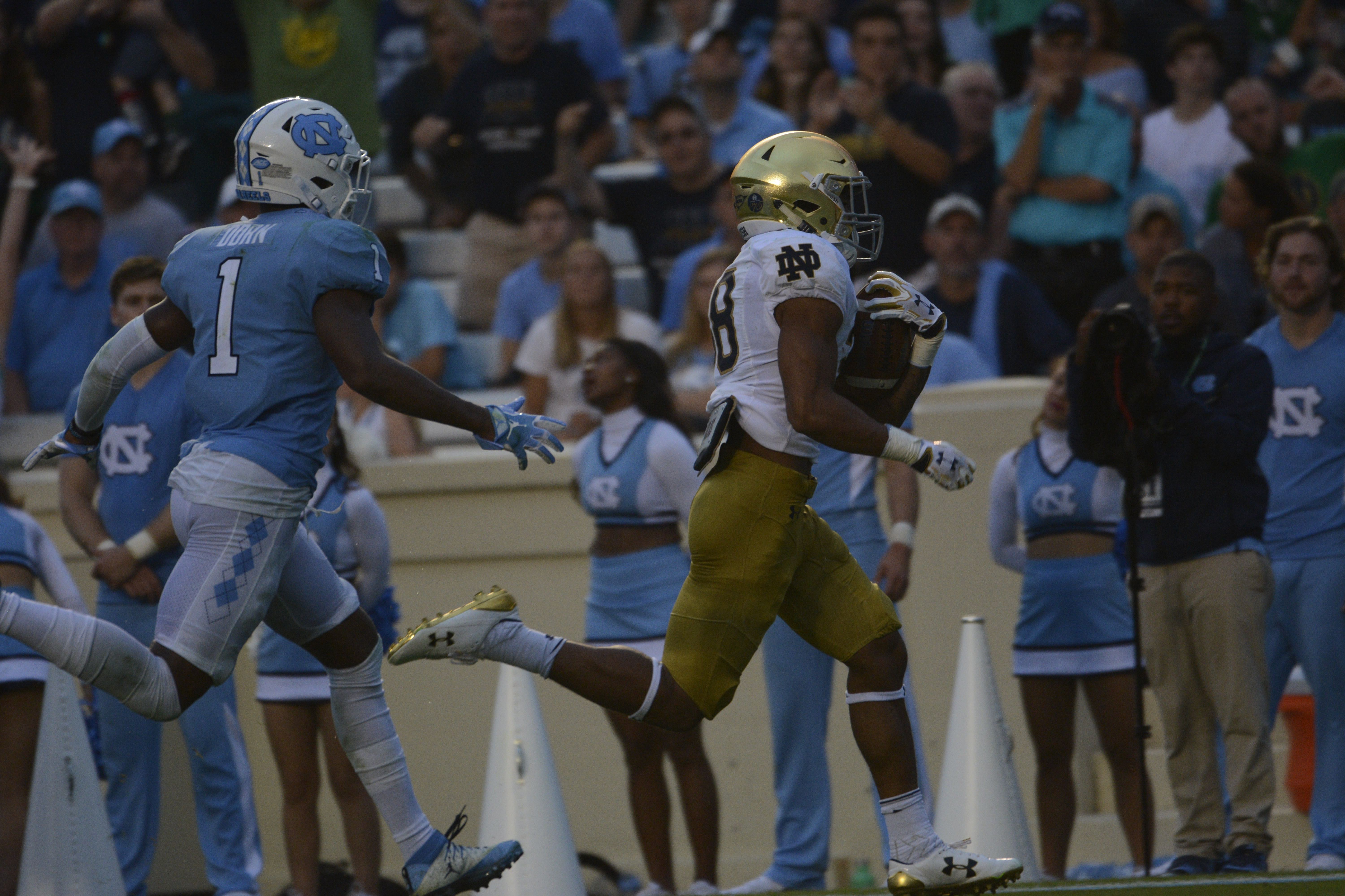 Irish sophomore running back Deon McIntosh outpaces a defender during Notre Dame's 33-10 win over North Carolina on Saturday at Kenan Memorial Stadium in Chapel Hill, North Carolina.