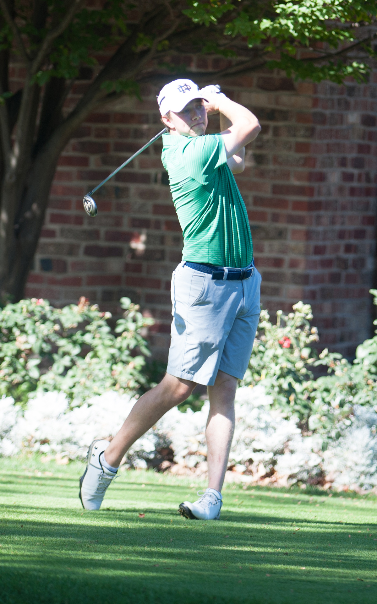 Irish junior Kevin Conners tees off win an iron during the Fighting Irish Classic on Sunday at Warren Golf Course.