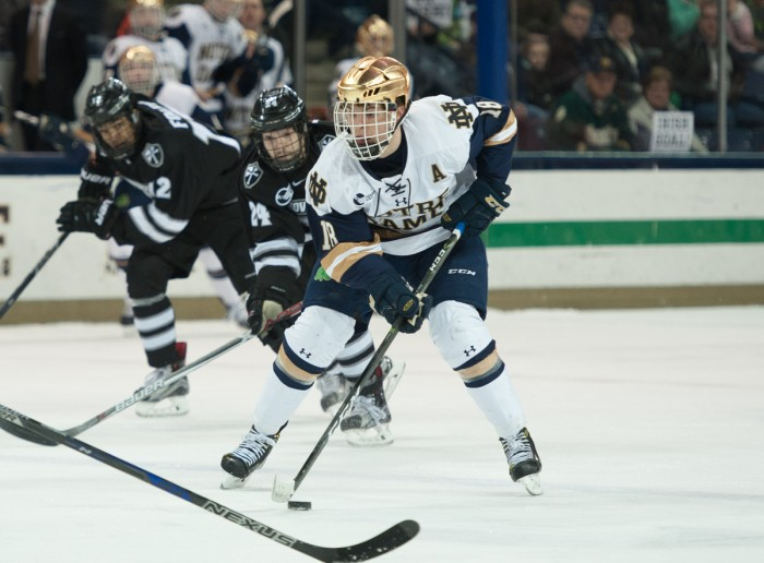 Irish senior forward Jake Evans carries the puck up the ice during Notre Dame's 5-2 win over Providence on March 11.