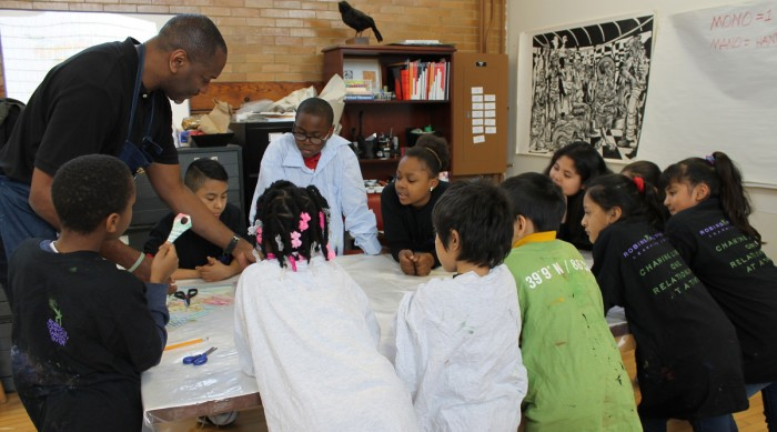 Artist Steve Prince leads children in the Notre Dame Center for Arts and Culture's (NDCAC) after school program in a mono type print workshop activity in March 2017. The NDCAC offers a variety of educational programs.