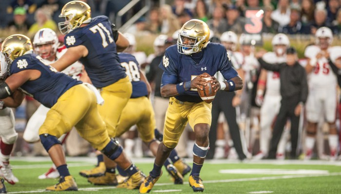Irish junior quarterback Brandon Wimbush rolls out of the pocket during Notre Dame's 52-17 victory over Miami (OH) on Sept. 30 at Notre Dame Stadium.