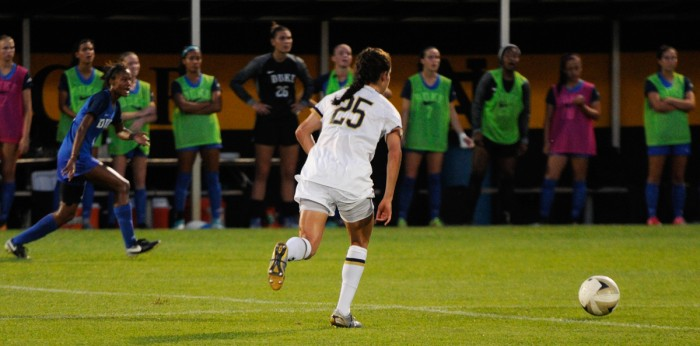 Irish senior defender and co-captain Monica Flores dribbles upfield during Notre Dame's 3-0 loss to Duke on Sept. 21 at Alumni Stadium. Flores scored her first career goal on Senior Night against Virginia Tech.