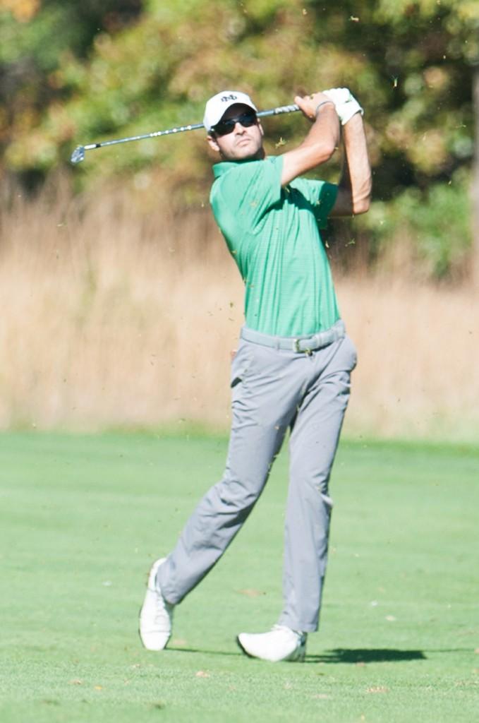 Irish junior Miguel Delgado follows through on an iron during the Fighting Irish Classic on Oct. 8 at Warren Golf Course.