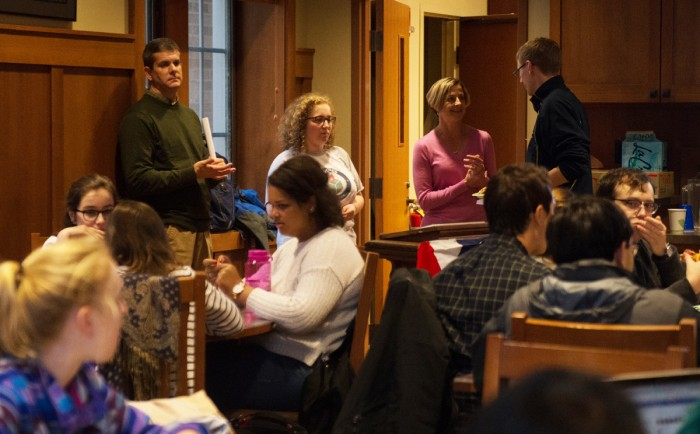 """Students attend """"Pizza, Pop and Politics"""" in the Geddes Coffee House. Professor David Campbell discussed the political implications and causes of rising secularism in the United States."""