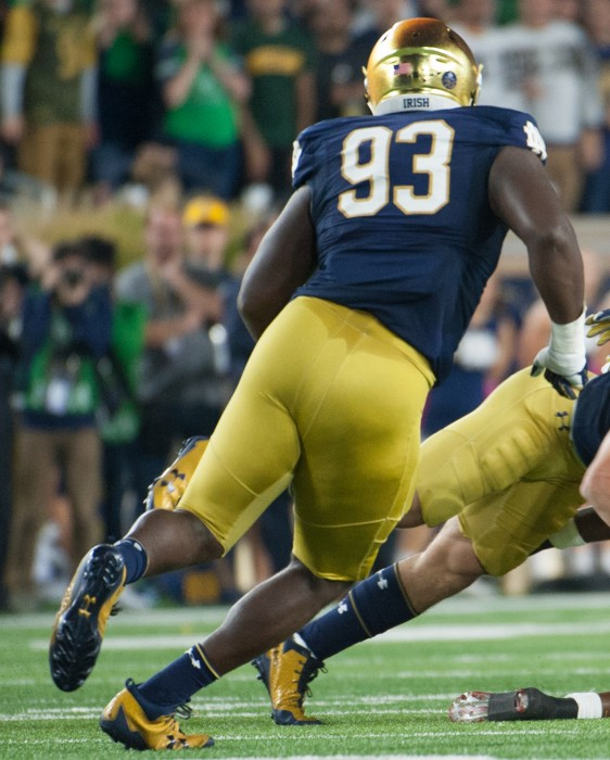 Jay Hayes rushes in to make a tackle against USC on Sat. at Notre Dame Stadium.